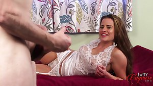 Clothed slut Sarah Snow spreads her legs to tease a naked man