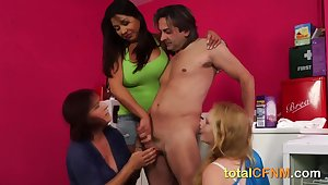 Naked guy gets a blowie from three Rabelaisian bimbos